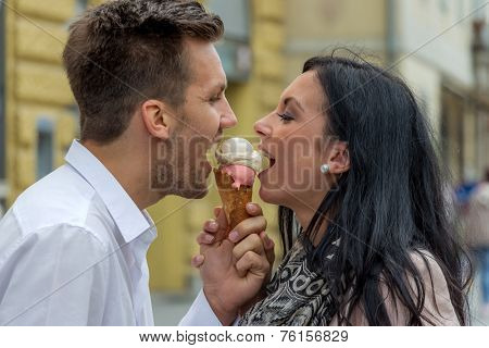 a young couple with a bag of ice. ice cream cones as a refreshment in summer