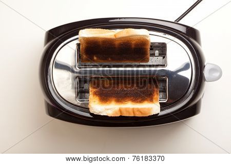 Black Toaster, Two Burnt Black Slices Of Bread