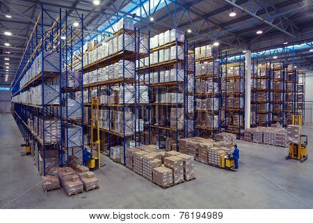Palletising With Foodstuffs Stand On A Rack Shelf Goods Warehouse.