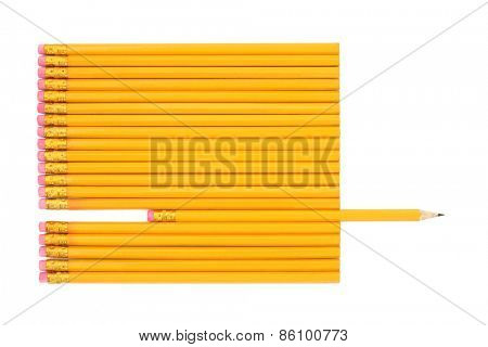 Lead pencils with one pencil sharpened and protruding over white background.
