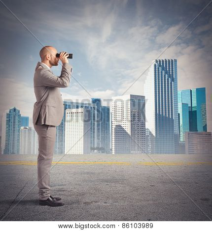 Businessman observes from a distance
