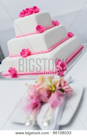 white Wedding Cake decorated with pink flowers