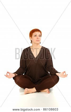 The girl with red hair meditates