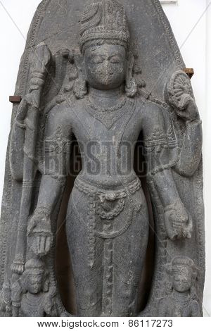 KOLKATA, INDIA - FEBRUARY 15: Standing Hari-Hara, from 10th century found in Basalt Surajkund, Nalanda, Bihar now exposed in the Indian Museum in Kolkata, on February 15, 2014