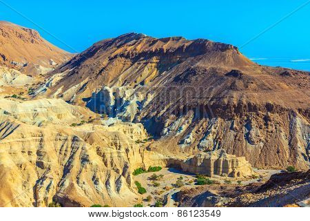 Picturesque multicolored sandstone dry talus. Ancient mountains in the valley of the Dead Sea