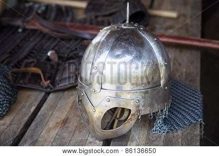 Replica Of Viking Helmet On Wooden Table
