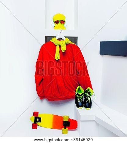 Skateboard Accessories. Skateboard, Sweatshirt, Sneakers, Headphones, Hat, Glasses In White Interior