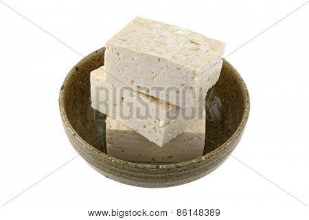 Closeup photography of fresh Japanese Momen (cotton) tofu, isolated on white