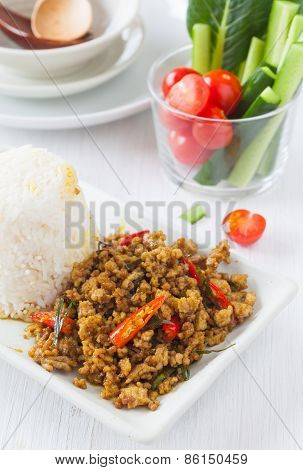 Spicy fried pork with chili paste and herb