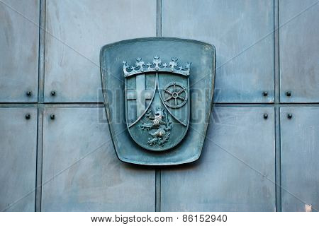 Relief Carving On A Metallic Door - Caot Of Arms