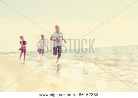Blurred children running on the beach, focus on sand in foreground. Instagram effect