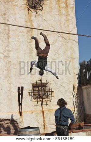 A Cowboy Stuntman Falls Off a Building