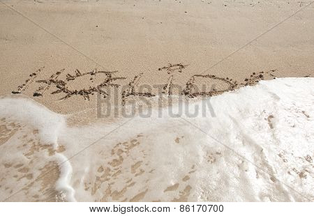 Holiday Written In The Sand