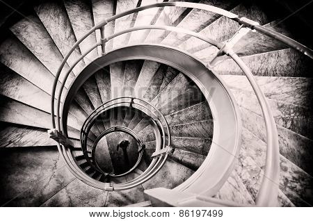 Walking Woman In Center Of Spiral Stairs