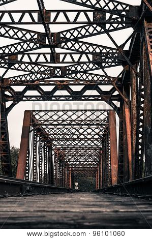Train Tracks Crossing A Rusty Steel Bridge