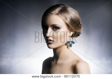 Portrait of beautiful girl in shiny jewels. poster