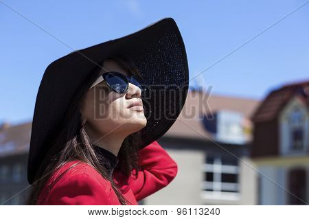 Brunette Female Portrait Looking At The Sun