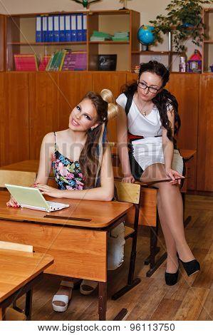 Teacher Looks Making Pupil At Laptop.