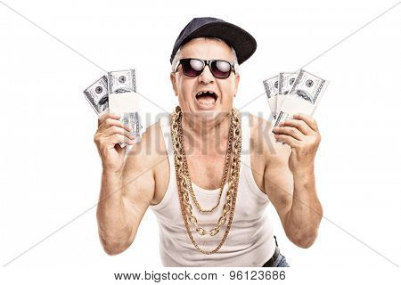 Delighted senior in hip hop outfit holding a few stacks of money and looking at the camera isolated on white background poster