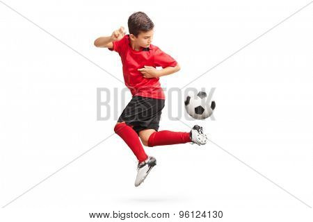 Studio shot of a junior soccer player performing a trick with a soccer ball isolated on white background poster