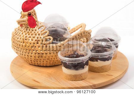 Blueberry Cheesecake In Plastic Package On Wooden Tray