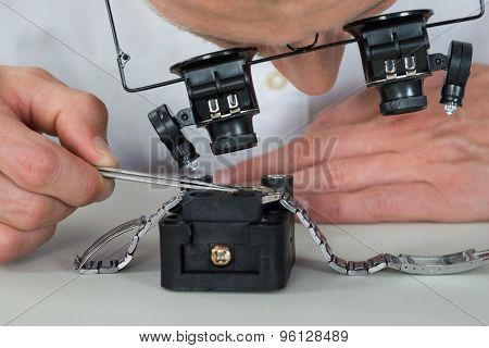 Watchmaker Repairing Wrist Watch