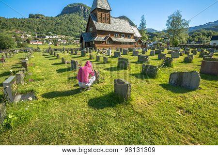 Praying in cemetery