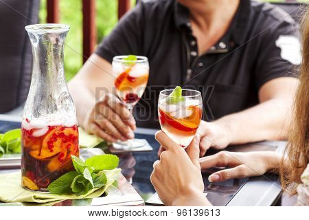 Couple Drinking White Sangria.