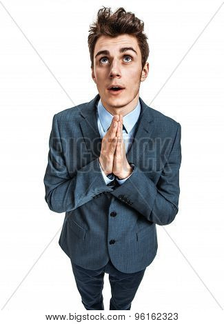 Praying Businessman Is Looking Upwards
