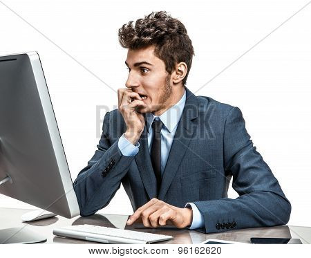 Employer Looking At Computer Screen With Horror