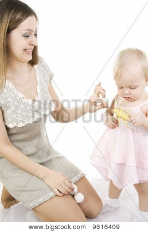 Daughter and fastidious mother holds a toy of an insect in the hands poster