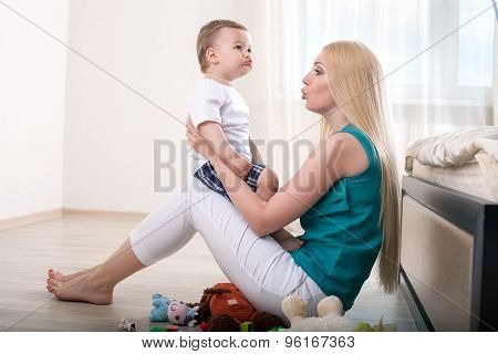 Pretty young woman is spending time with her small son