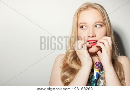 Cheerful young girl is longing for something very much