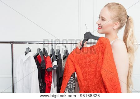 Pretty young girl is shopping in store