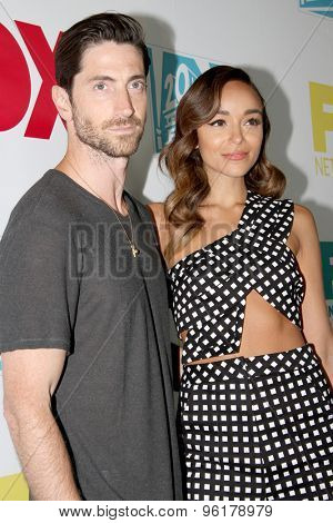 SAN DIEGO, CA - JULY 10: Iddo Goldberg and Ashley Madekwe arrives at the 20th Century Fox/FX Comic Con party at the Andez hotel on July 10, 2015 in San Diego, CA.