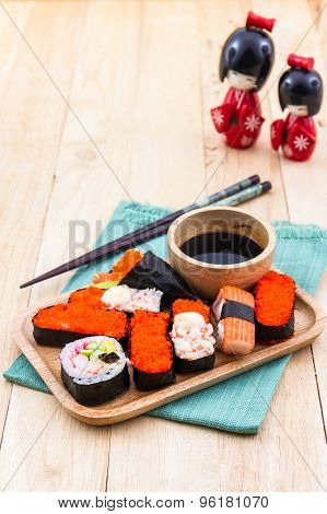 Japanese Sushi Traditional Food On Wooden Plate .
