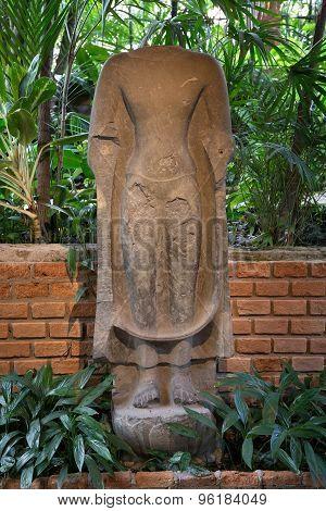 Beheaded ancient Buddha statue