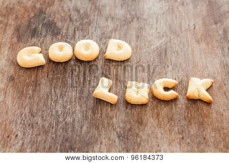 Good Luck Alphabet Biscuit On Wooden Table