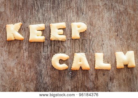 Keep Calm Alphabet Biscuit On Wooden Table
