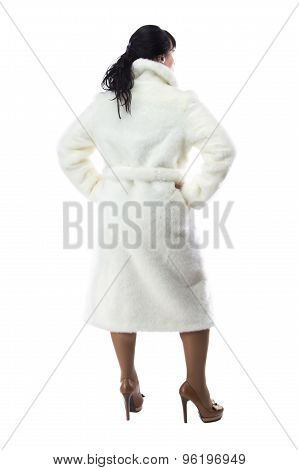 Photo of pudgy woman in long coat, from back