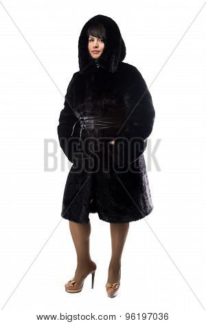 Pudgy brunette in black coat with hood
