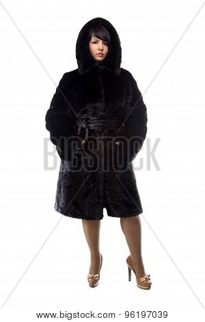 Pudgy woman in black coat with hood
