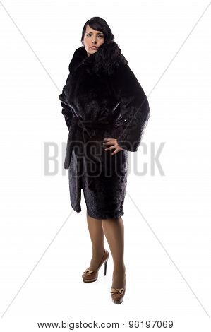 Image of pudgy brunette in black coat