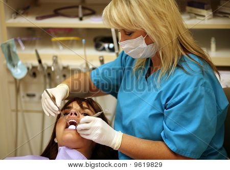 Hygenist And Patient At Dentist