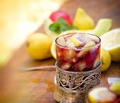 Refreshment in hot summer days - cold sangria on table poster