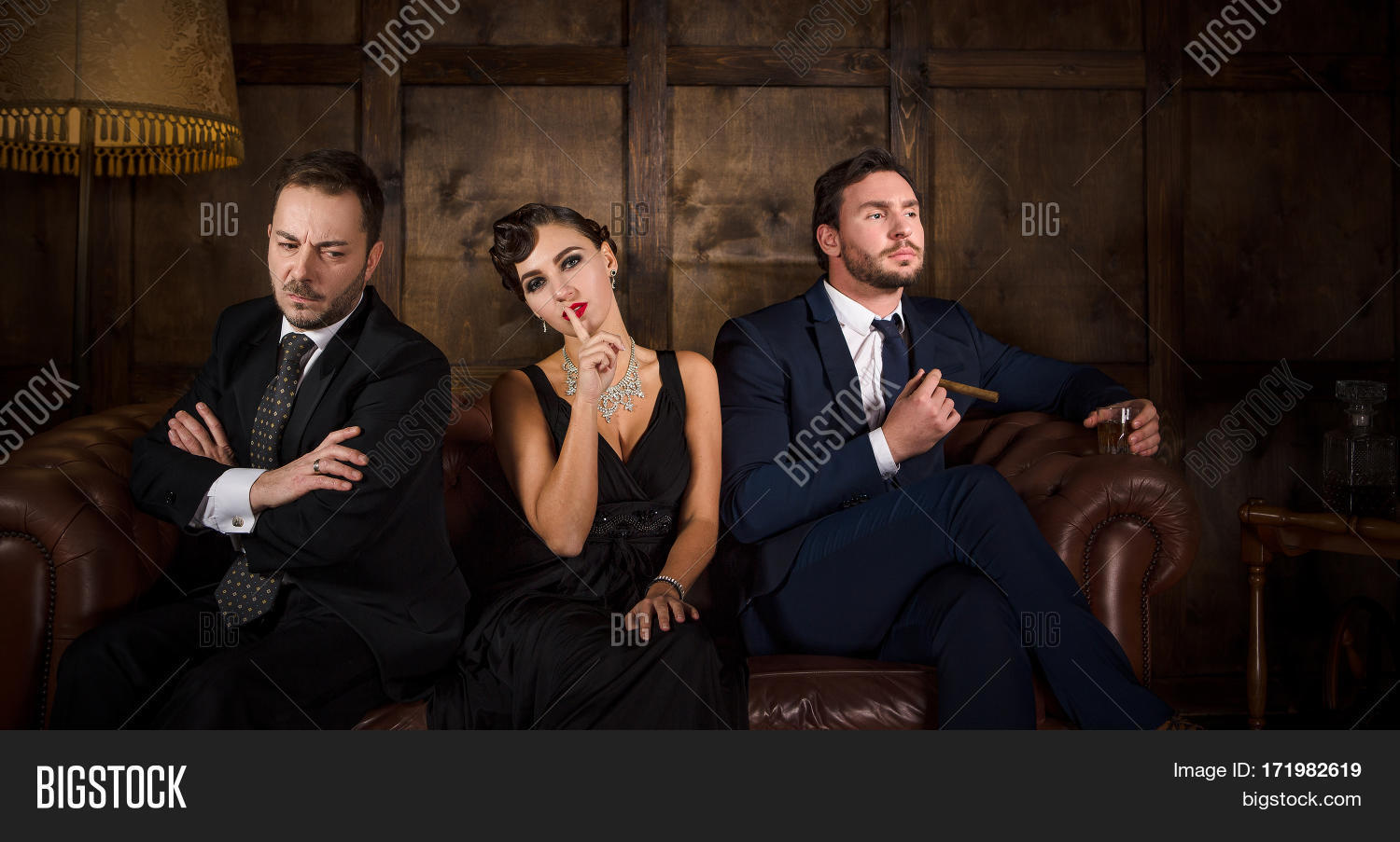 572ba8f228 Rivalry or competition between two handsome rich executive men for elegant lady  with red lips.