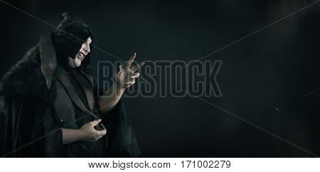 Crazy Smiling Vampire With Scary Nails. Undead Monster. Text Place