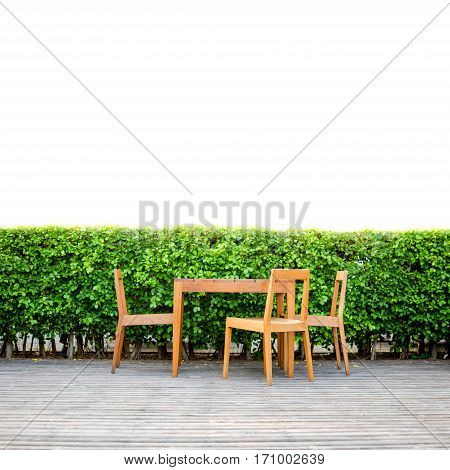 Table Set On Wooden Deck With Banyan Tree Background