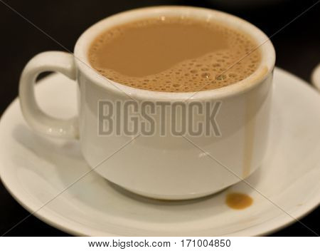 COLOR PHOTO OF CUP OF MILK TEA