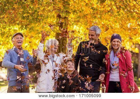 Happy multi-generation family enjoying at park during autumn